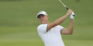 Noren leads in Malaysia; McIlroy three back