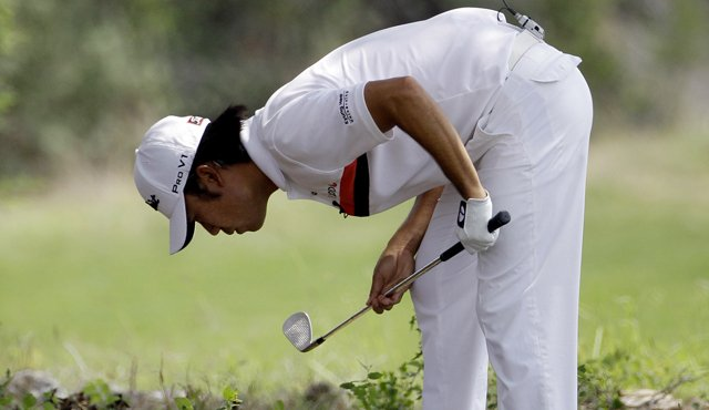 Kevin Na looks at his lie on the eighth hole during the first round of the Texas Open.