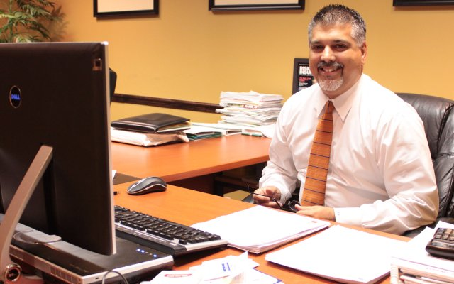Ivan Valdes sits at his desk on April 13 at his Maitland financial firm. He'll be sworn in to the Maitland City Council on Monday, April 25.