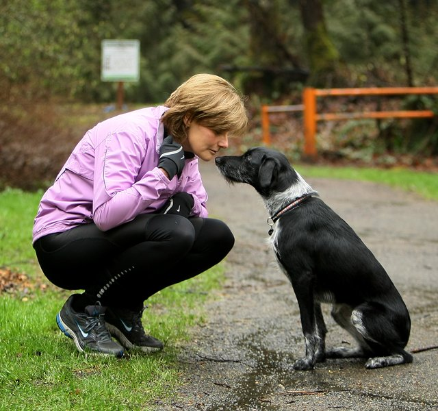 Nike&#39;s Cindy Davis and her puppy before a long run in Oregon.