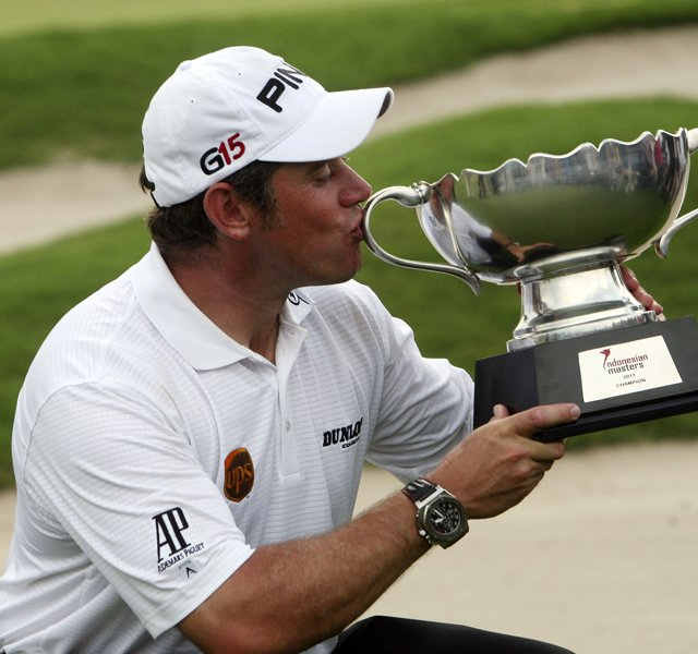 Lee Westwood of England kiss the trophy after winning the Indonesian Masters golf tournament at Royale Jakarta Golf Club in Jakarta, Indonesia,Sunday, April 24, 2011. 