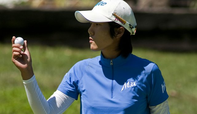 Song-Hee Kim acknowledges the crowd on the ninth green during the final round of the 2010 Northwest Arkansas Championship.