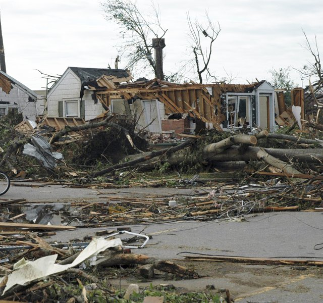 A man pauses to look at the damage from a tornado that ripped through Tuscaloosa, Ala., near the University of Alabama, on Wednesday. 