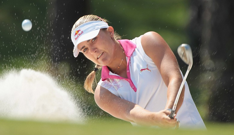 Alexis Thompson watches a bunker shot on the 16th hole during the third round of the 2011 Avnet LPGA Classic.