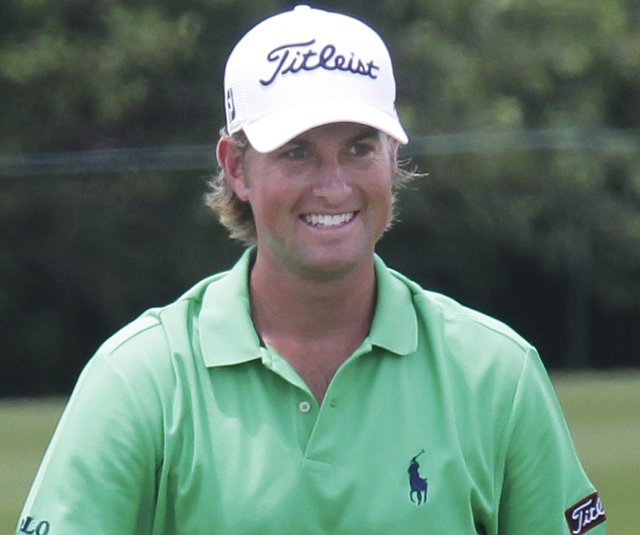 Web Simpson is all smiles after chipping in for a birdie on the seventh hole during the third round of the 2011 Zurich Classic.