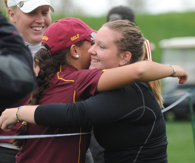 Minnesota's Teresa Puga, left, hugs teammate Samantha Sommers after the Golden Gophers advanced to the NCAA Division I championship.
