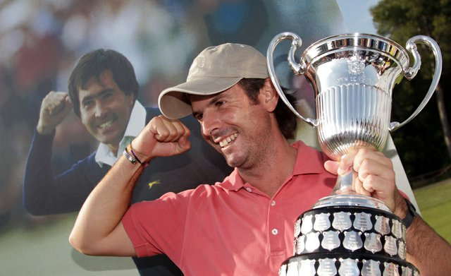 Thomas Aiken of South Africa with the winners trophy after the final round of the Open de Espana at the Real Club de Golf El Prat on May 8 , 2011 in Barcelona, Spain.