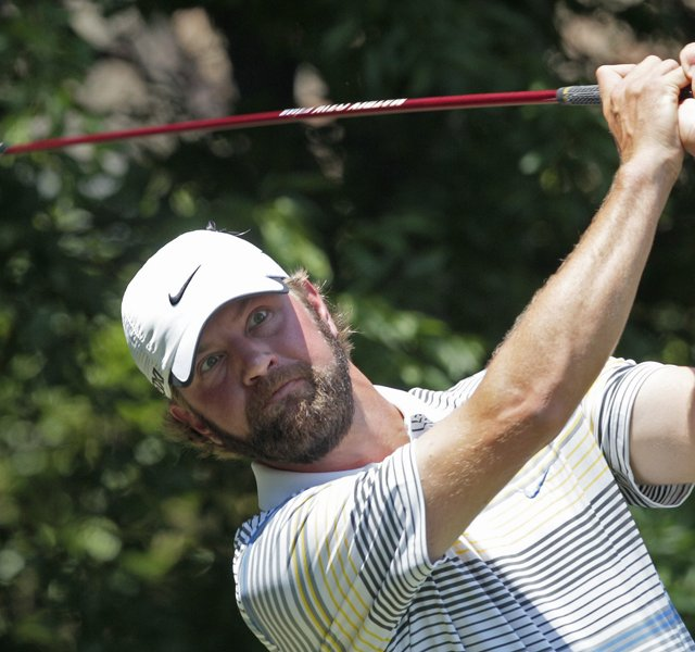 Lucas Glover hits from the fifth tee during the final round of the Wells Fargo Championship golf tournament at Quail Hollow Club in Charlotte, N.C., Sunday, May 8, 2011.