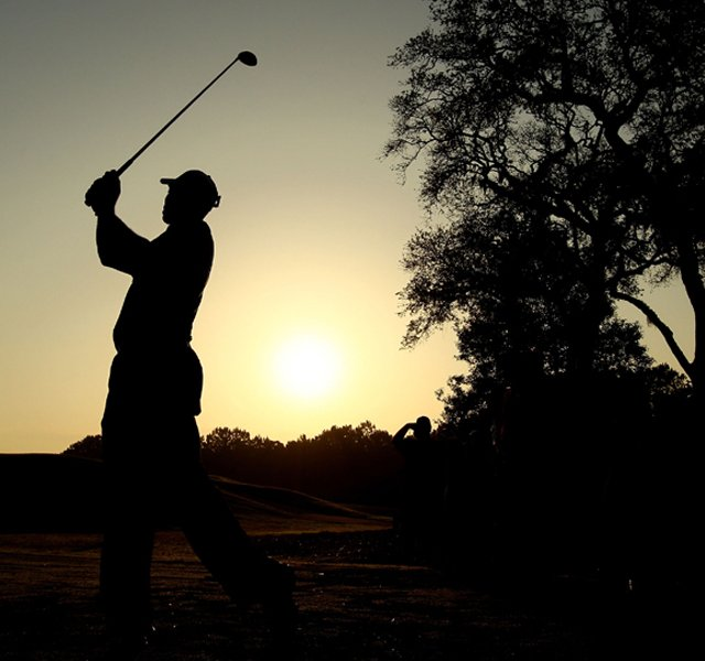 Tiger Woods hits a shot during a practice round prior to the start of the 2010 Players Championship.