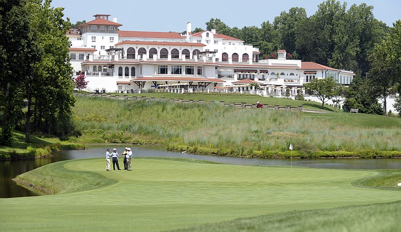 U.S. Open officials, lower left, inspect the 18th green at Congressional Country Club in Bethesda, Md., Friday, July 23, 2010.