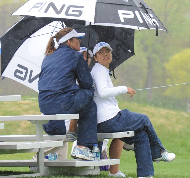 UCLA coach Carrie Forsyth and Stephanie Kono watch the Bruins finish at the 2011 NCAA Women's Regional in Indiana.