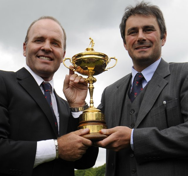 Frenchmen Thomas Levet (left) and Jean Van de Velde hold the Ryder Cup after it was announced May 17 that France will host the 2018 Ryder Cup.