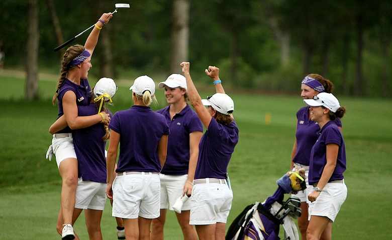 LSU's Austin Ernst celebrates after winning the individual title at the women's NCAA Championship.