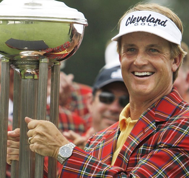 David Toms wears the winner&#39;s jacket and holds up the Colonial trophy after winning the golf tournament in Fort Worth, Texas, Sunday, May 22, 2011.