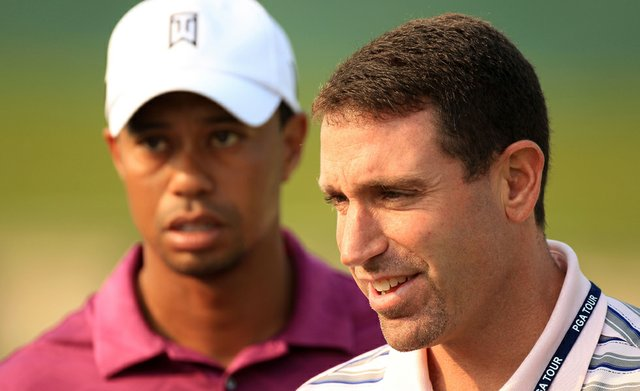 Tiger Woods, left, and agent Mark Steinberg