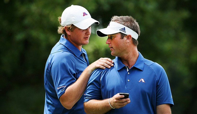 Augusta State head coach Josh Gregory (right) talks with Henrik Norlander during the final round of stroke play at the NCAA Championship.