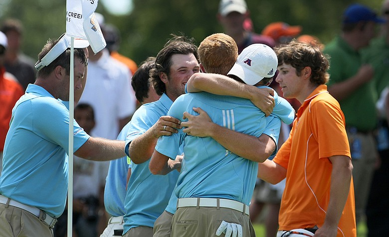 Augusta State celebrates after defeating Oklahoma State during Semifinals of Saturday's Match Play at the 2011 NCAA Division I Men's Golf Championship at Karsten Creek in Stillwater, Oklahoma.-