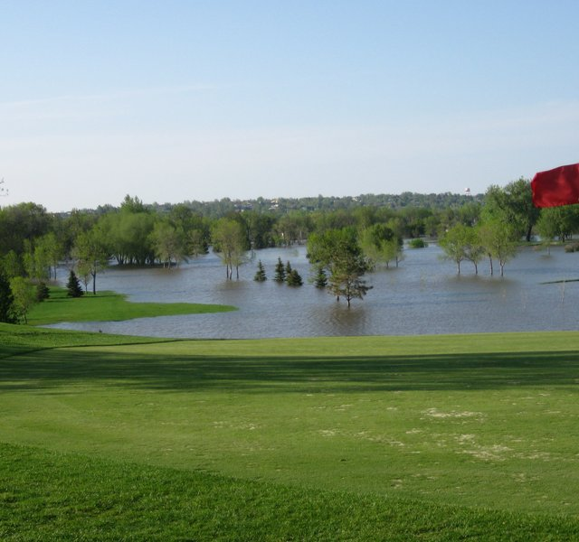 Looking north across Souris Valley Golf Course at two normally dry upland holes, the 414-yard par-4 fourteenth hole (left) and the 522-yard, par-5 15th (right).
