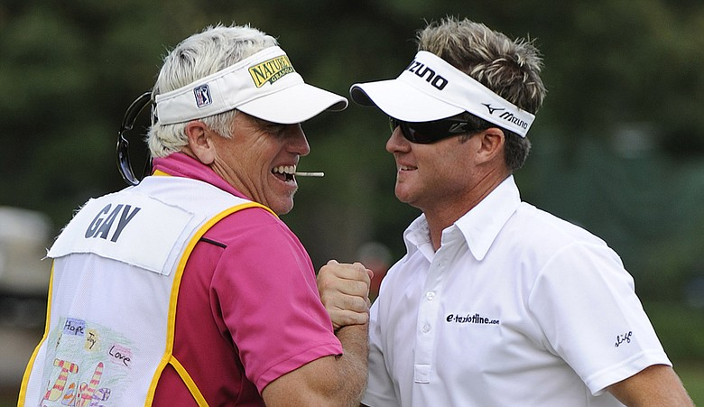 Brian Gay, right, celebrates with caddie Kip Henley at the 2010 St. Jude Classic.