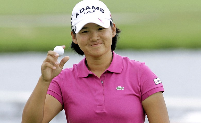 Yani Tseng of Taipei, Taiwan acknowledges the gallery on the 18th green during the third round of the LPGA State Farm Classic golf tournament Saturday, June 11, 2011 in Springfield, Ill.