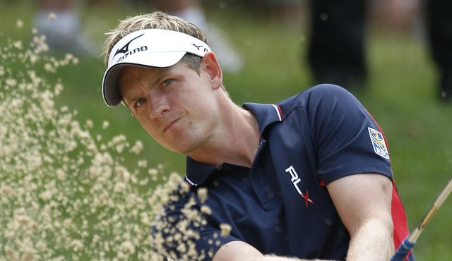 Luke Donald blasts out of the sand during Round 1 of the U.S. Open.