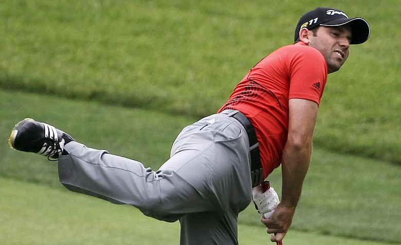 Sergio Garcia, of Spain, watches his shot from the ninth fairway during the third round of the U.S. Open Championship golf tournament in Bethesda, Md., Saturday, June 18, 2011.