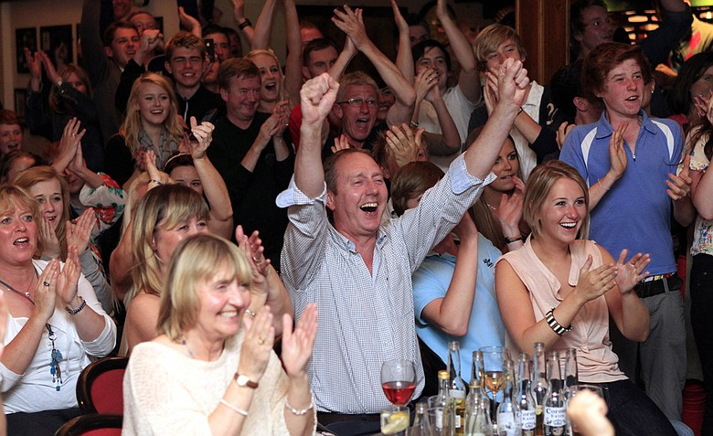 Members of Holywood golf club in Northern Ireland react early Monday, June 19, 2011 after watching Rory McIlroy win the U.S. Open Golf Championship on TV.