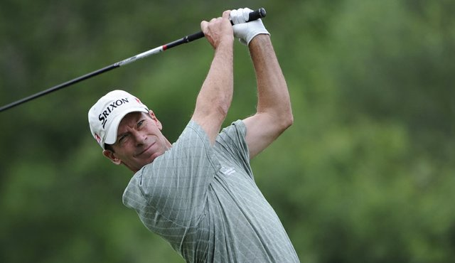 John Huston tees off on the ninth hole during the final round of the Dick's Sporting Goods Open.