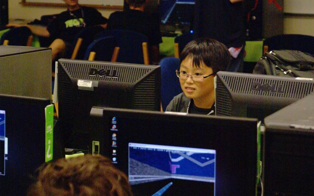 Would-be game designers team up to play a computer game tournament against each other at iD Tech Camps at Rollins College on June 21.