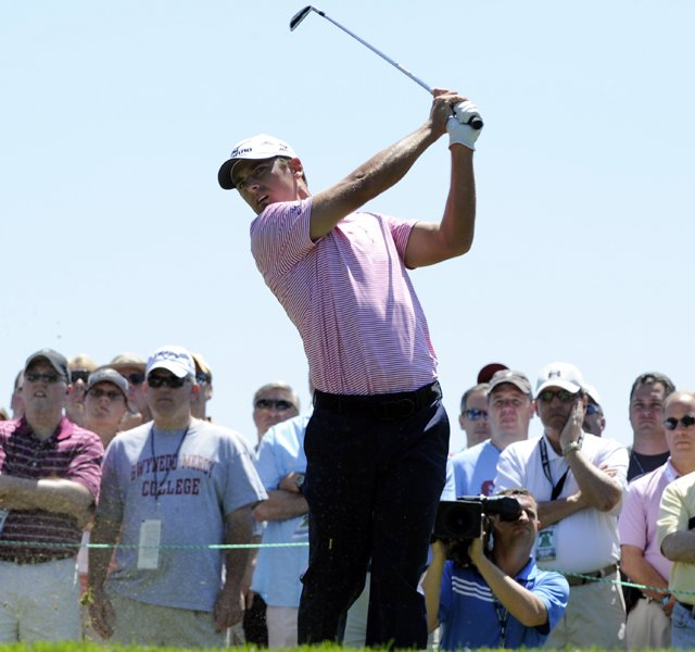 Charles Howell III tees off on the eighth hole during the second round of the AT&T National golf tournament at Aronimink Golf Club, Friday, July 1, 2011, in Newtown Square, Pa.