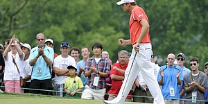 Blog: Watney's driver, putter are the difference