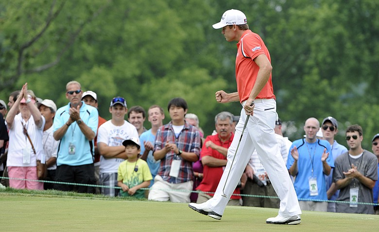 Nick Watney pumps his fist after making a putt on the fourth hole in the final round of the AT&T National golf tournament at Aronimink Golf Club, Sunday, July 3, 2011, in Newtown Square, Pa.