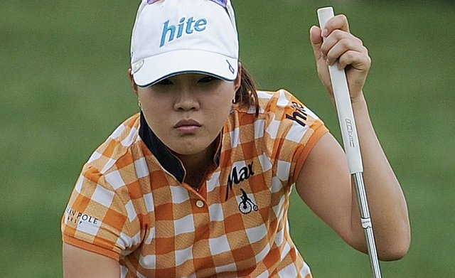 Hee Kyung Seo of South Korea lines up a putt on the 10th green during the fourth round of the Women's U.S. Open golf tournament at the Broadmoor Golf Club on Sunday, July 10, 2011, in Colorado Springs, Colo.