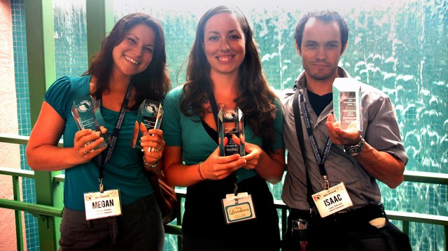Observer Newspapers editors (from left) Megan Stokes, Jenny Andreasson and Isaac Babcock show off some of the eight awards they received at the Florida Press Association's annual convention, held this year in St. Petersburg.