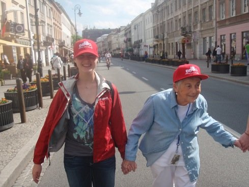 Winter Park student Laurel Cohen walks with a holocaust survivor through the old city of Warsaw, Poland during her trip to learn about the holocaust during WWII.