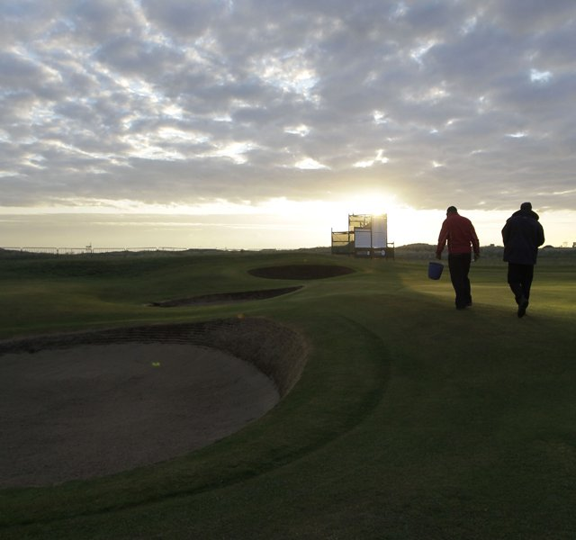 Workers prepare Royal St. George's to host the 2011 British Open.