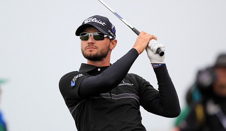 Kyle Stanley plays a shot on the 18th fairway during the first round of the 140th British Open.