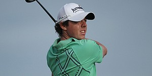 McIlroy finds motivation in Clarke's solid play