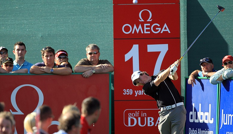 Rory McIlroy plays his tee shot at the 17th hole during the final round of the 2011 Omega Dubai Desert Classic.