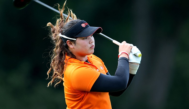 Ariya Jutanugarn watches her tee shot at No. 15 during the Round of 16 at the 63rd U. S. Girls' Junior Championship at Olympia Fields Country Club.