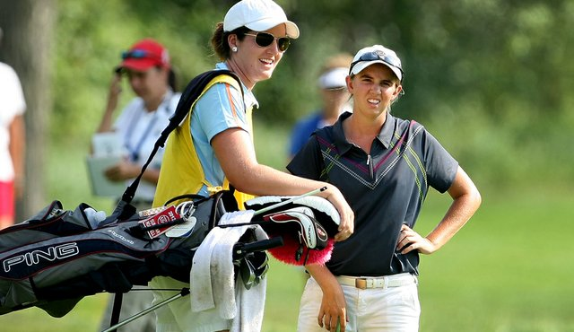 Summar Roachell and her caddie Nora Lucas during the Round of 16 at the 63rd U.S. Girls' Junior Championship at Olympia Fields Country Club.