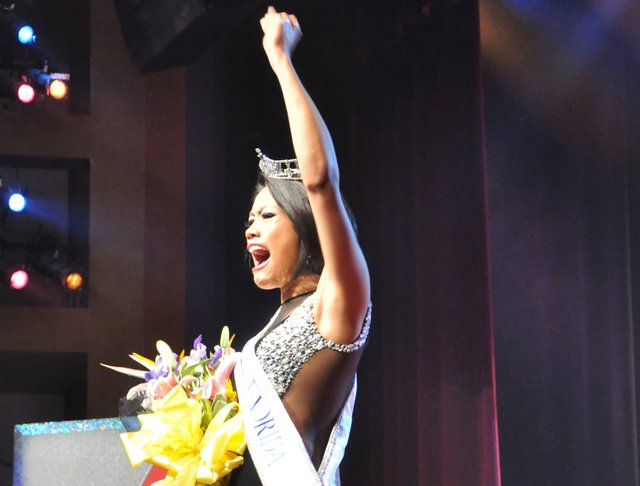The newly crowned Miss Florida, Kristina Janolo, waves to the crowd on July 9. She won Miss Winter Park earlier this year.