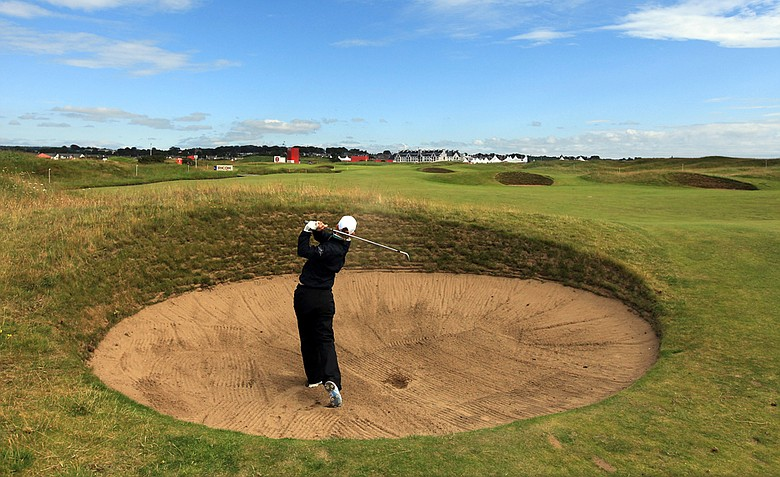 Christel Boeljon plays a shot out of a fairway bunker during a practice round for the 2011 Ricoh Women's British Open at Carnoustie.