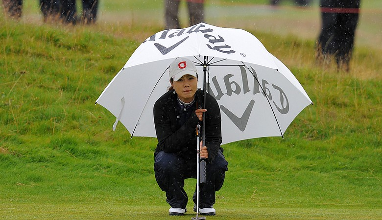 Meena Lee lines up her putt on the 16th hole during the first round of the Women's British open at Carnoustie.