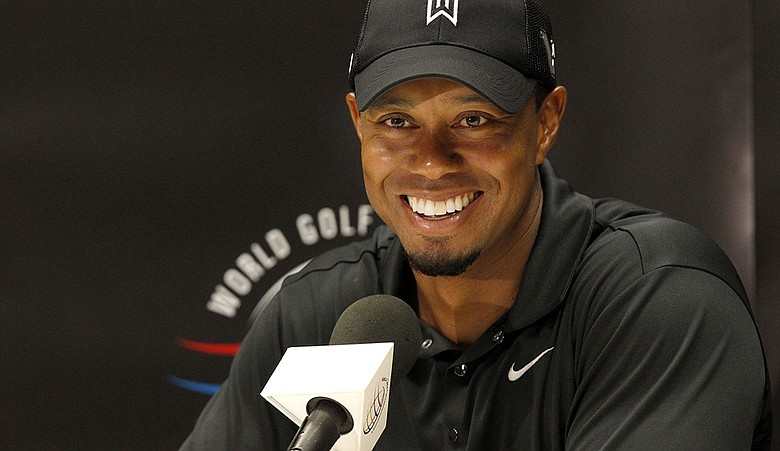 Tiger Woods talks to the media during a press conference after a practice round for the 2011 World Golf Championships Bridgestone Invitational at Firestone Country Club.