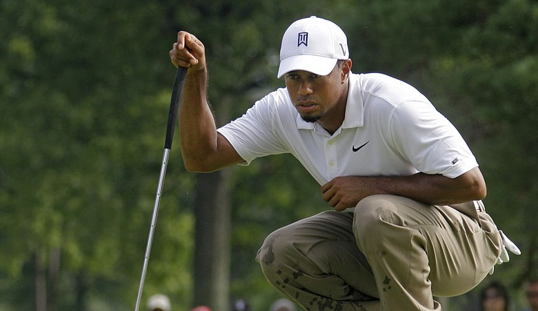 Tiger Woods reads a putt during Round 2 of the Bridgestone Invitational.