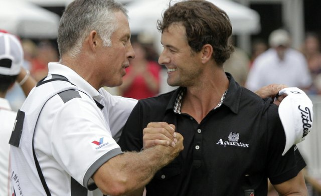 Adam Scott, right, is congratulated by caddie Steve Williams after winning the Bridgestone Invitational golf tournament at Firestone Country Club in Akron, Ohio, Sunday, Aug. 7, 2011. Scott finished at 17-under par for a four-shot win.