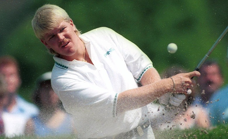 John Daly of Memphis, Tenn. blasts out of a trap on the first hole during final round action at the PGA championship in Carmel, Ind., Aug. 11, 1991. Daly, who would win the tournament, took a bogie on the hole.
