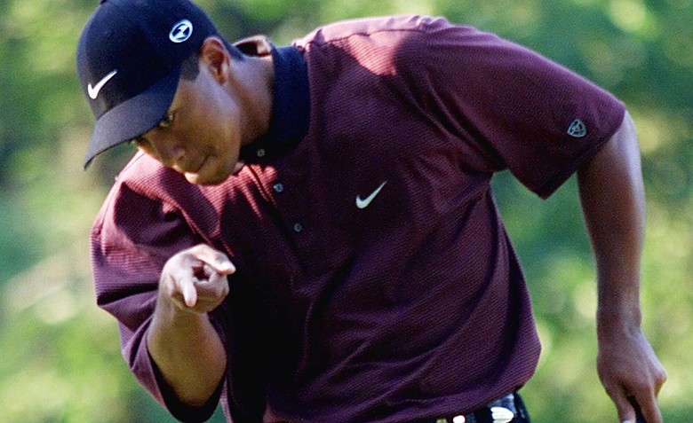 Tiger Woods points to his ball as it drops for birdie on the first hole of a three-hole playoff against Bob May at the PGA Championship, Sunday, Aug. 20, 2000, at the Valhalla Golf Club in Louisville, Ky. Woods would win the tournament to capture his second PGA Championship.