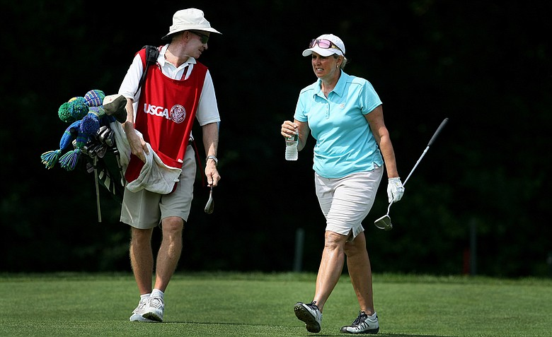 Alexandra Frazier with her caddie Bob Fleming during Tuesday stroke play of the U. S. Women's Amateur Championship at Rhode Island Country Club in Barrington, Rhode Island.